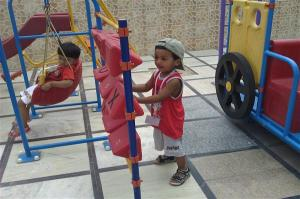 Children Enjoying in Play Area